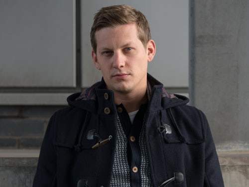John Paul McQueen (James Sutton)