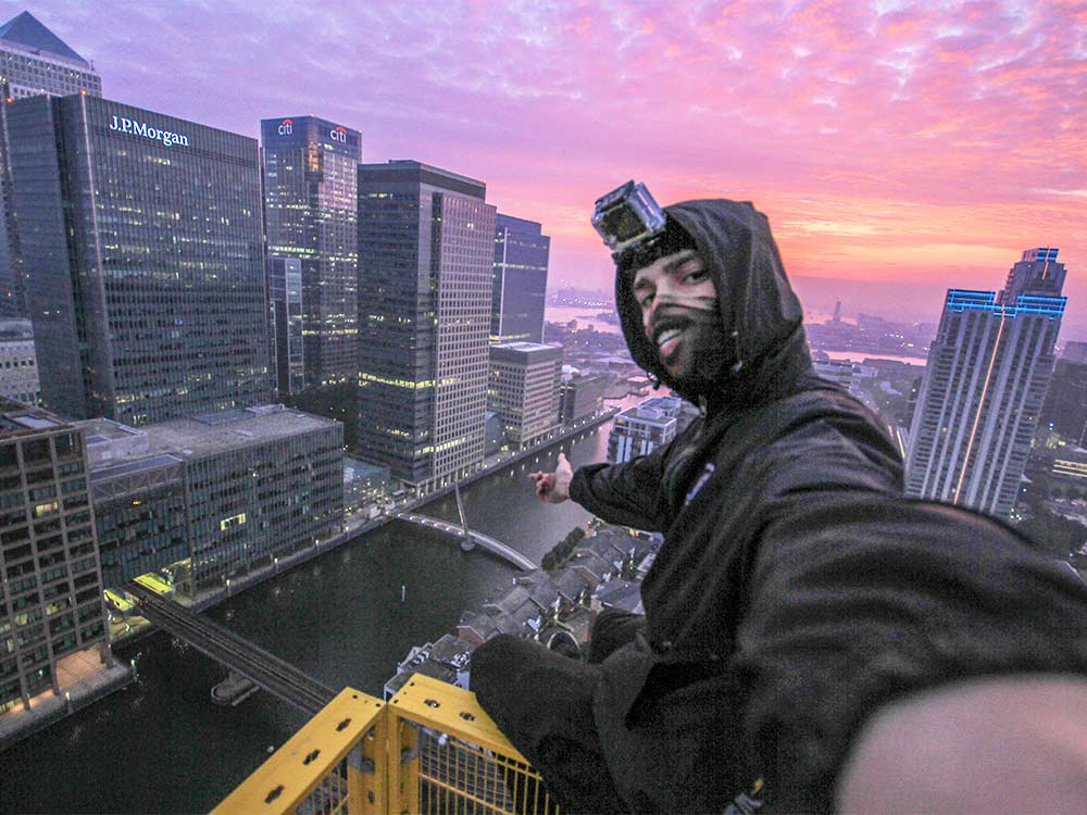 Urban Explorers looking over Canary Wharf, London