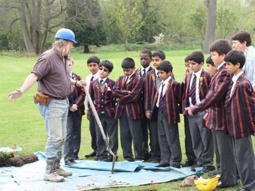 Phil gives a trench-side lesson to the prep school pupils
