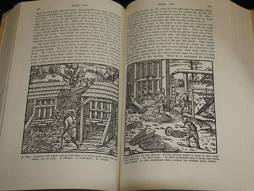 an open book with engravings of the mines