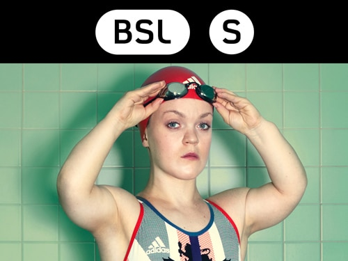 Ellie Simmonds holding goggles whilst in GB swimwear
