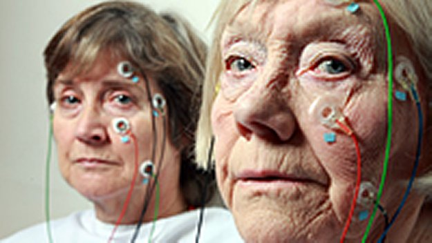 Two elderly ladies take a medical test