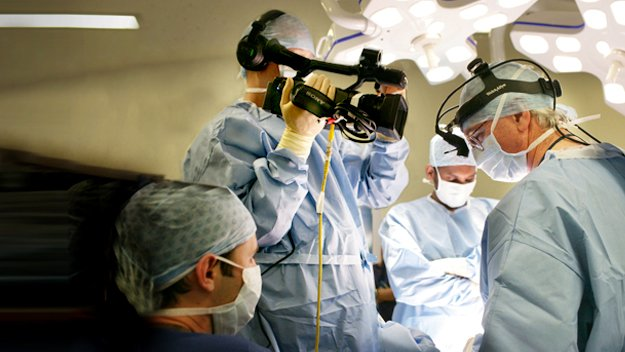 Surgeons carry out life-changing operations in front of a studio audience live on Channel 4, answering viewers' questions as they work