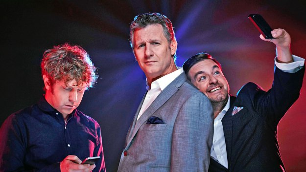 Adam Hills and co-hosts Josh Widdicombe and Alex Brooker provide some offbeat commentary on the significant moments of the past seven days
