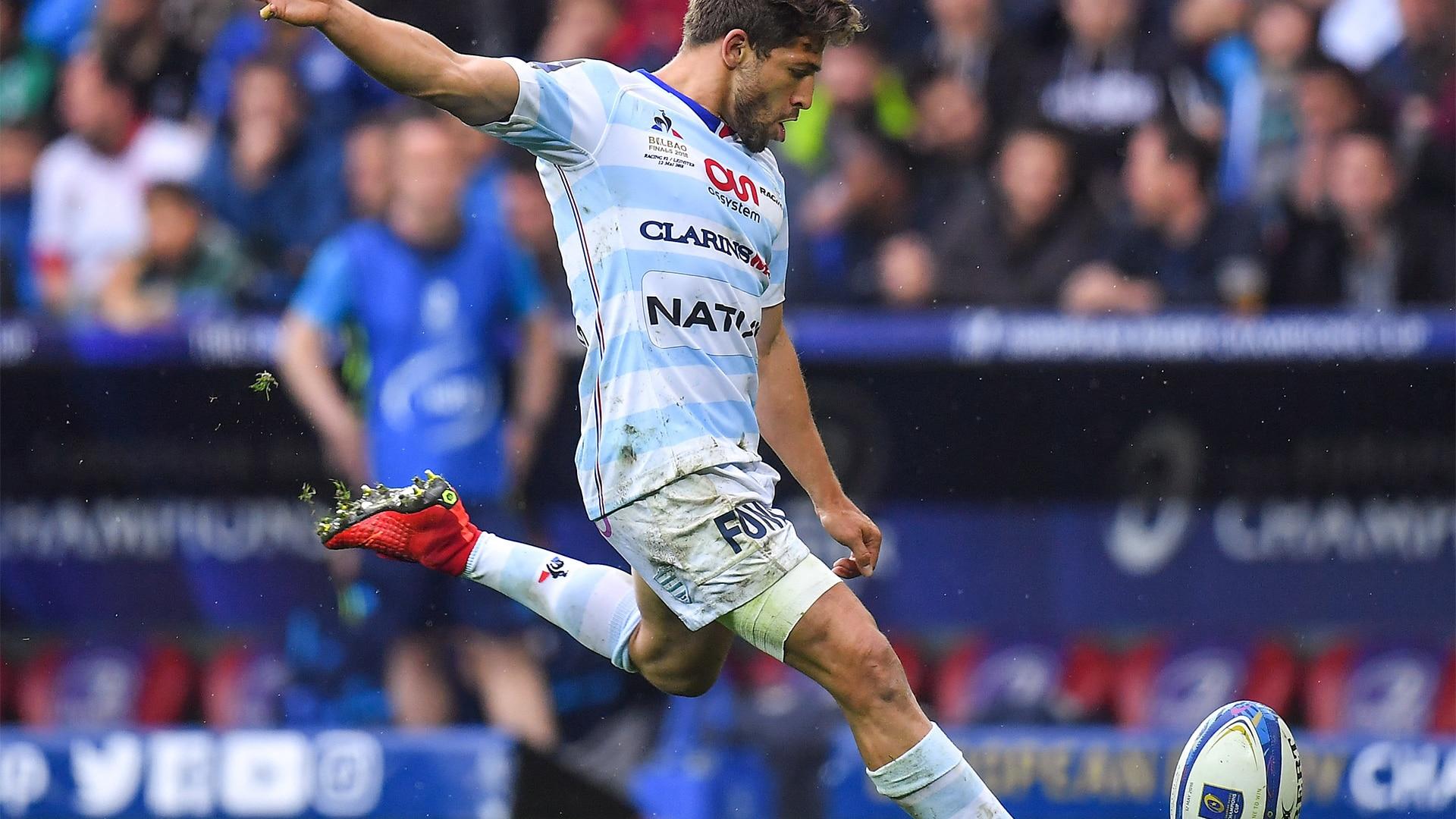 Man kicks rugby ball