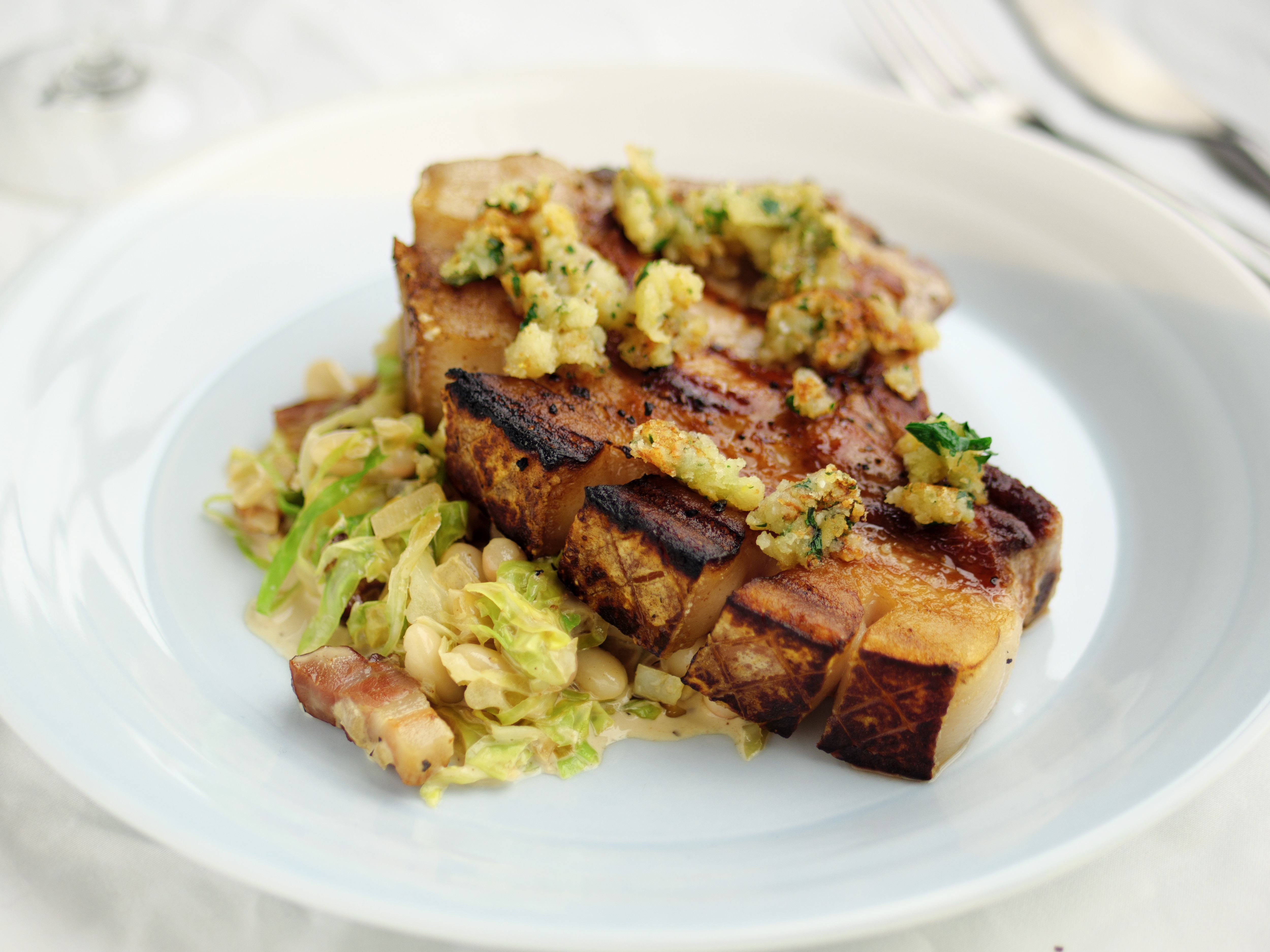Pork Chops With Cannellini Beans, Cabbage And Bacon