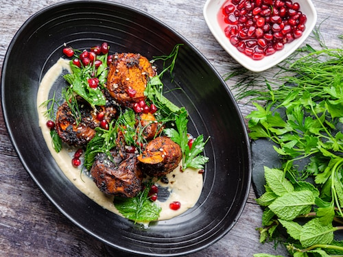 Burnt Sweet Potato With Tahini Sauce And Pomegranate
