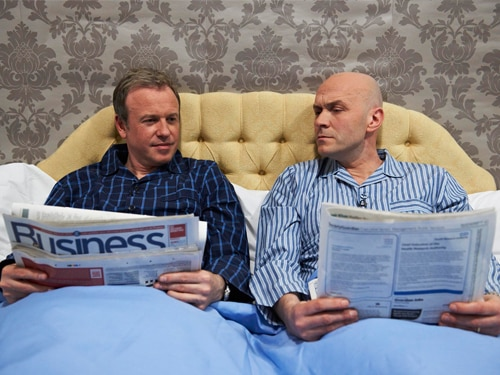 Tim and Simon in bed with the Sunday papers