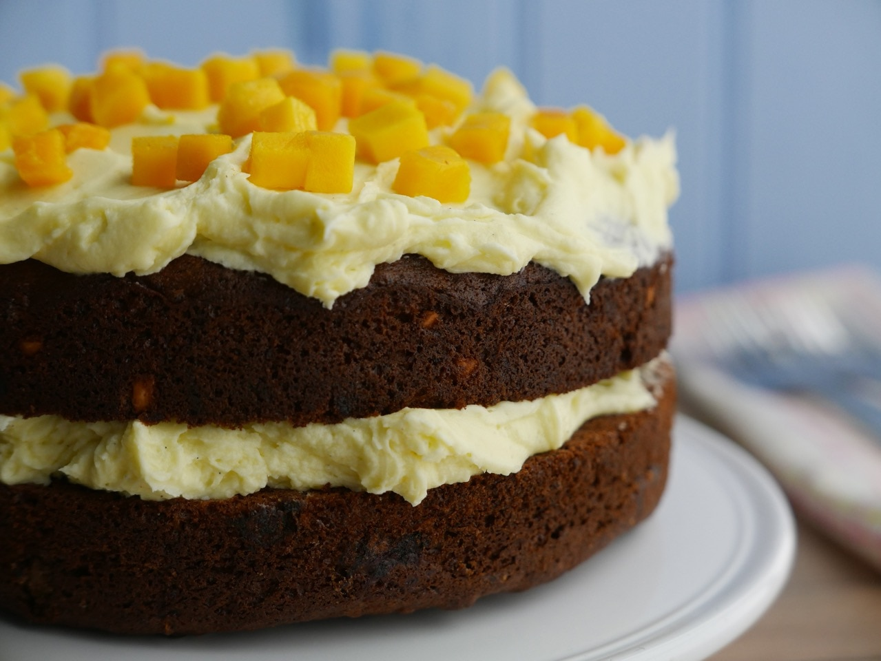 Banana Peanut Butter Cake with Mango Icing