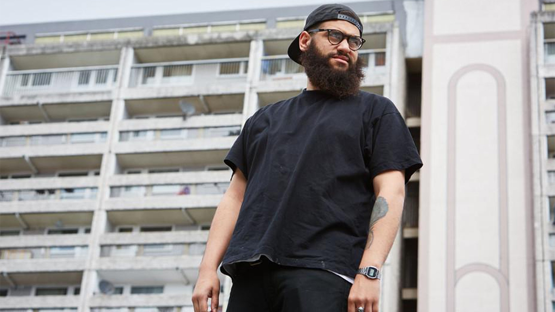 Jamali Maddix standing in front of flats