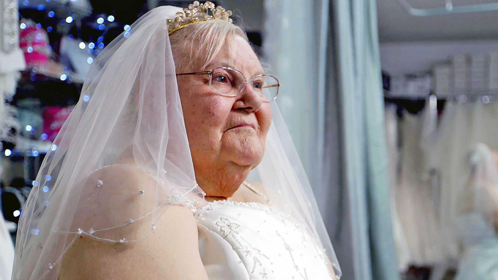 An elderly woman in a wedding dress