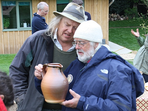 Phil and Mick examine a stone jug find