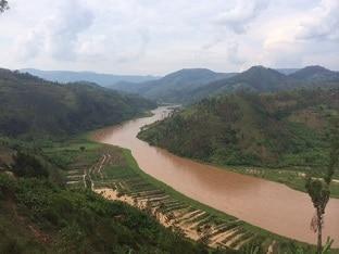 flooded fields beside swollen river