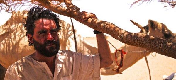 A photo of Lev seeking shade in the Bayuda Desert