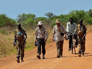 Photo of Lev and Boston walking in South Sudan