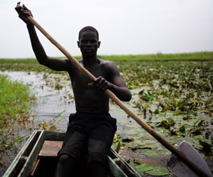 Photo of a man in a boat in South Sudan
