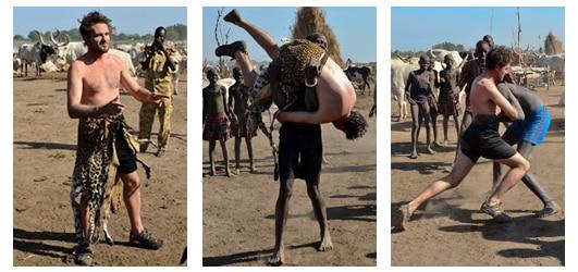 Photo of Lev wrestling with a Mundari tribesman