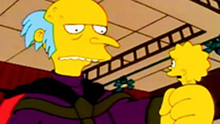 A giant Mr Burns clutching Lisa in his hand