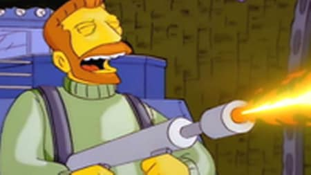 Hank Scorpio dealing death with a flamethrower